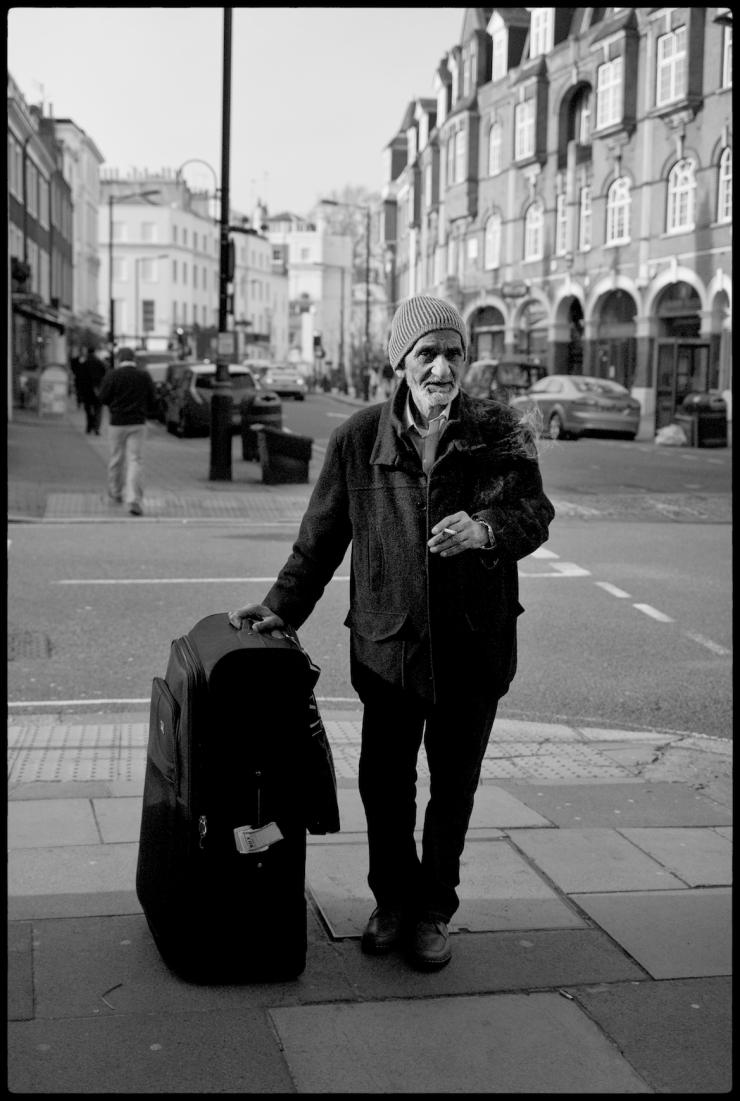 Indian man smoking and waiting, London