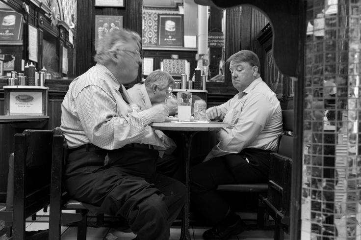 three big men enjoying food